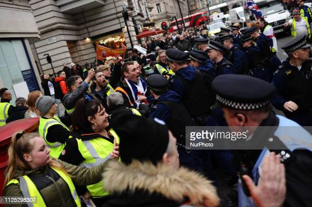 ProBrexit 'yellow vest' activists clash with police on Haymarket in London England on February 16 2019