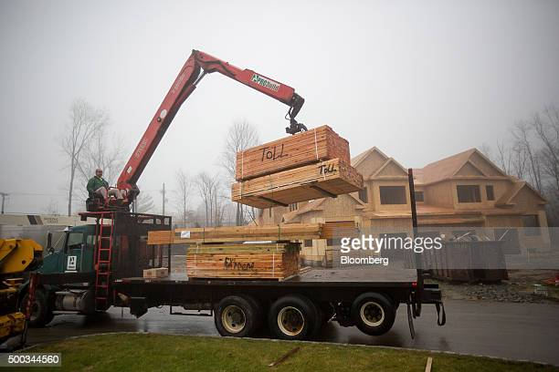Probuild Holdings Inc lumber is unloaded during construction at the Toll Brothers Inc Enclave at Rye Brook housing development in Rye Brook New York...