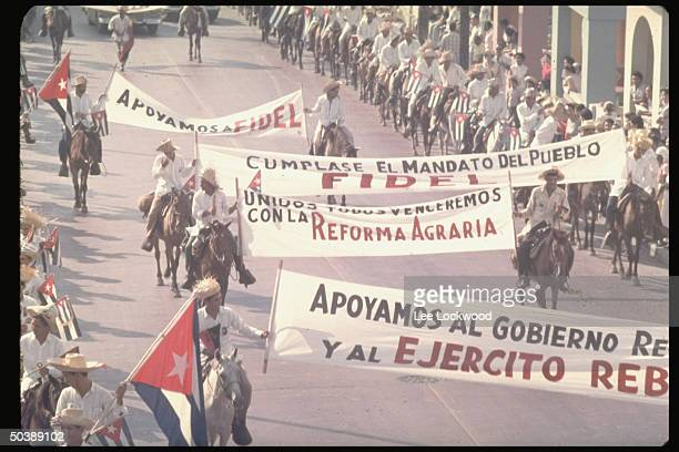 ProCastro rebels on horseback entering city displaying banners heralding the successful revolution on day of huge celebratory gathering