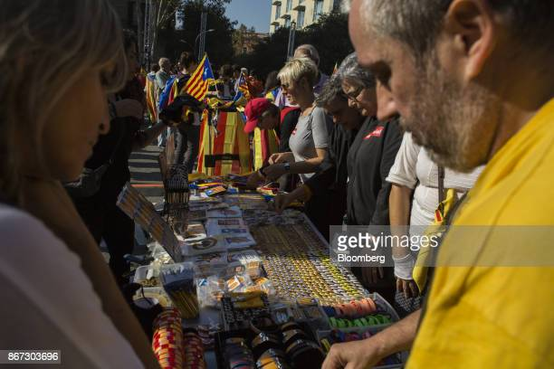 ProCatalan separatist supporters purchase souvenirs from street vendors in Barcelona Spain on Friday Oct 27 2017 Catalonias tumultuous push for...