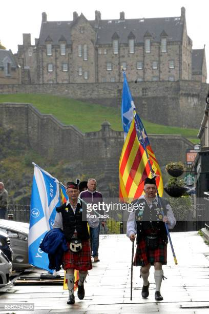 ProCatalonia demonstrators protest outside the Spanish Consulate General in Edinburgh with Edinburgh Castle in the background on the day Catalonia...