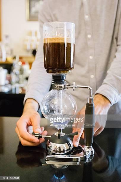 Process of coffee preparation using vacuum pot (syphon)
