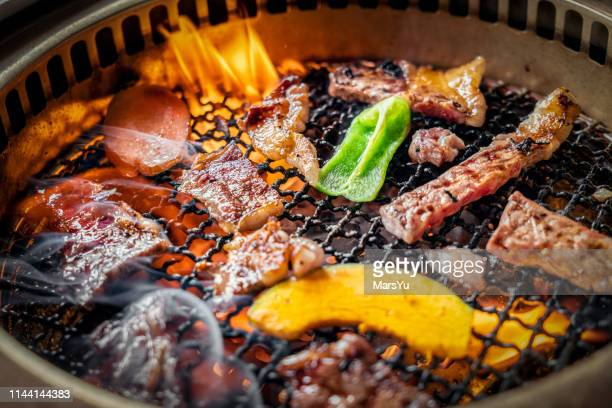 process of cooking  barbecue raw beef on grill in restaurant - korea stock pictures, royalty-free photos & images