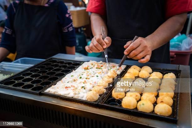 process to cooking takoyaki on hot pan famous food japan street food - 大阪 ストックフォトと画像
