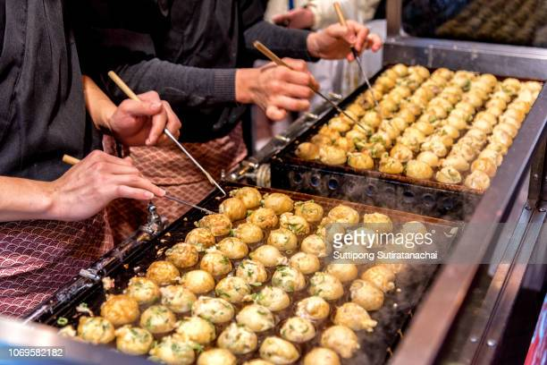 process to cooking takoyaki on hot pan famous food osaka japan street food - osaka prefecture stock pictures, royalty-free photos & images