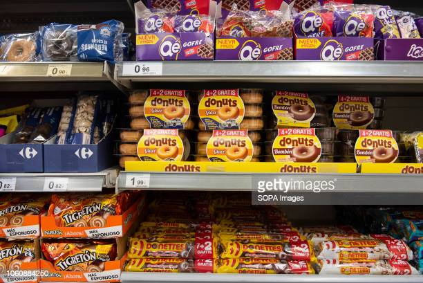 Processed bakery goods are displayed for sale at a Carrefour supermarket in Spain