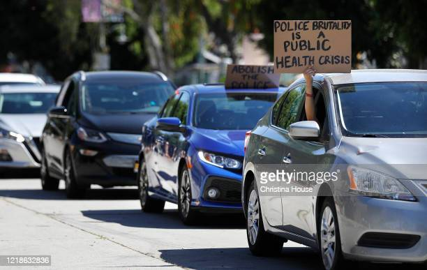 A procession departs Leimert Park for downtown Los Angeles for a memorial service to honor George Floyd and demand justice for those killed by the...