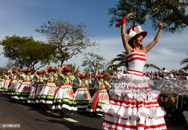 Procession during Festa da Flor on Aenida do Mar in Funchal