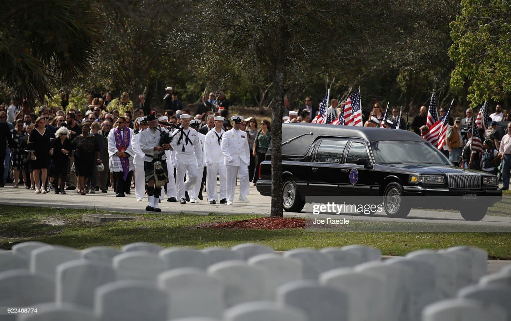 A procession follows the hearse as Chris Hixon, who was the athletic director at Marjory Stoneman Douglas High School is laid to rest at South Florida National Cemetery after he was killed along with 16 other students and teachers on February 21, 2018 in Lake Worth, Florida. Police arrested 19 year old former student Nikolas Cruz in the killing at the high school on February 14th.