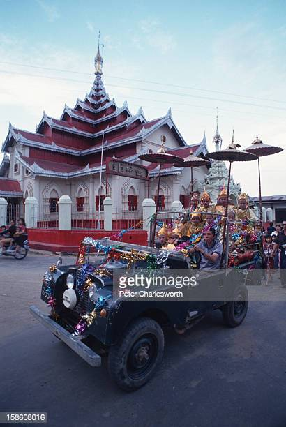 A procession for a coming of age ceremony for boys passes by Wat Jao Lung a Buddhist temple in Chieng Tung a small town in Shan State Burma