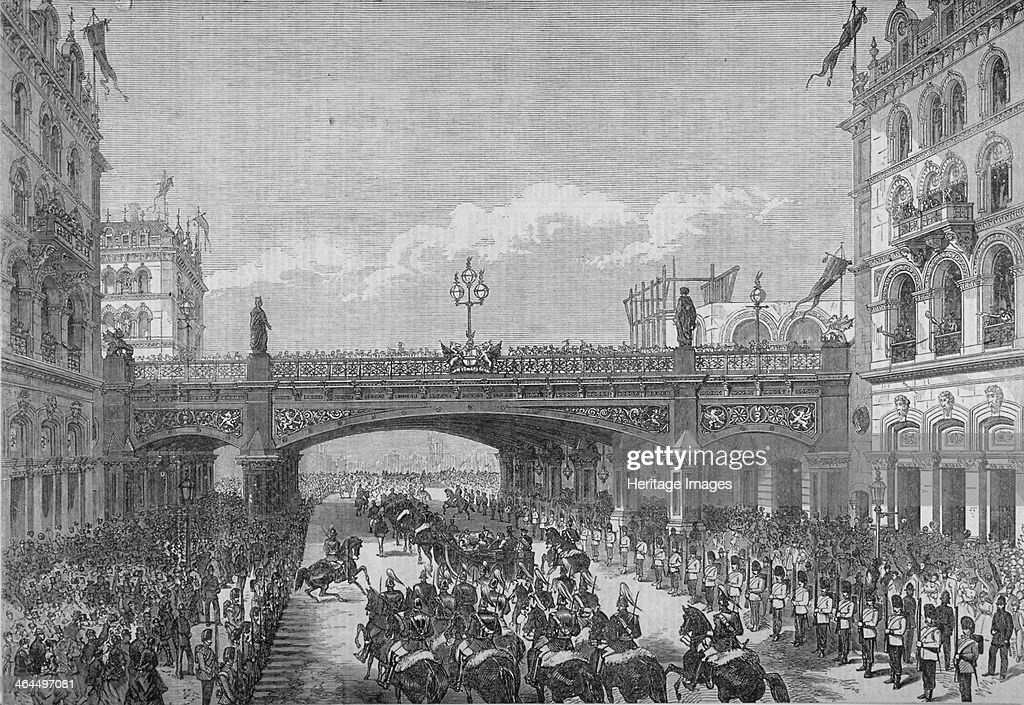 A procession in Farringdon Street passing under Holborn Viaduct, City of London, 1869. Artist: Anon : News Photo