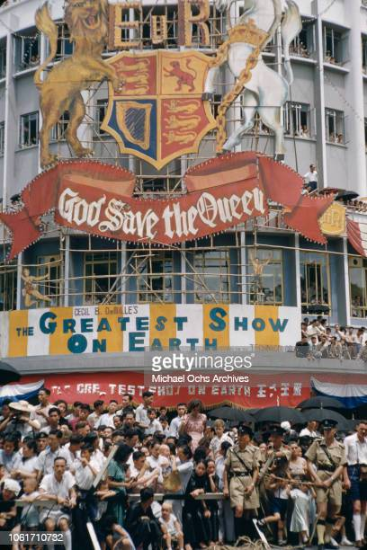 A procession in Hong Kong to celebrate the coronation of Queen Elizabeth II in London June 1953 A hoarding reading 'God Save the Queen' has been...