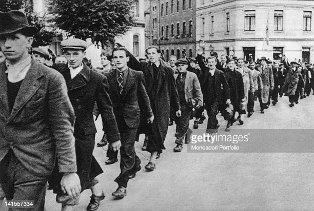 Procession of civilian inhabitants of the Sudetenland, Nazi sympathizers, marching through the town waving the Nazi salute, Czechoslovakia, September...