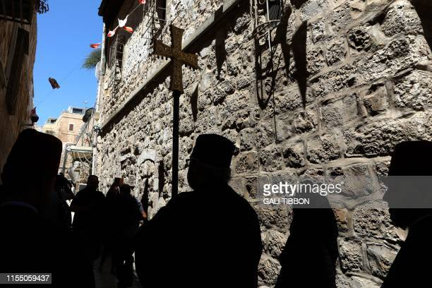 A procession of Greek Orthodox clergy escorts the Greek Orthodox Patriarch of Jerusalem together with the Franciscan Custodian of the Holy Land and...