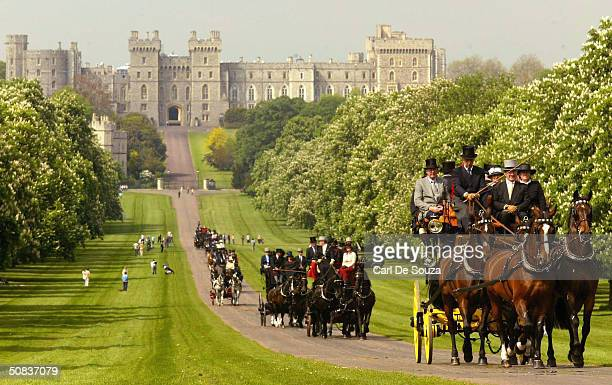 A procession of Horse carriages passes along the Long Mile in front of Windsor Castle on the second day of the Royal Windsor Horse Show at Home Park...