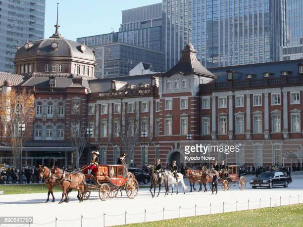 A procession of horsedrawn carriages carrying new Benin Ambassador Adechoubou Makarimi Abissola leaves JR Tokyo Station in a ceremonial trip to the...
