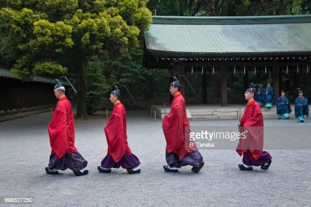 Procession of Kannushi Priests at Sacred Meiji-Jingu Shrine in Tokyo, Japan