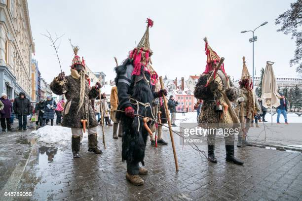 Procession of masked groups