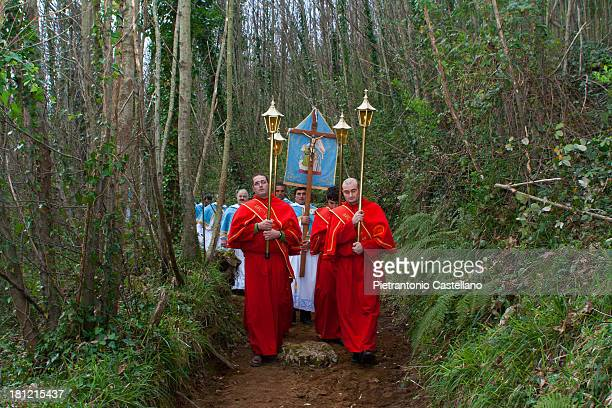 CONTENT] A procession of members of all religious brotherhoods of the Sorrentine Peninsula march through the woods towards the remote Memorial to the...