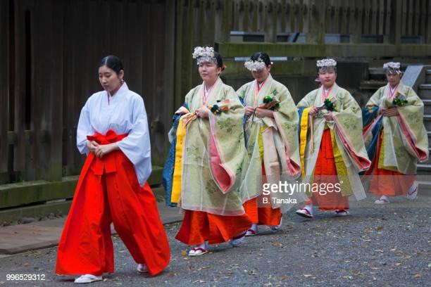 Procession of Miko Shrine Maidens at Sacred Meiji-Jingu Shrine in Tokyo, Japan