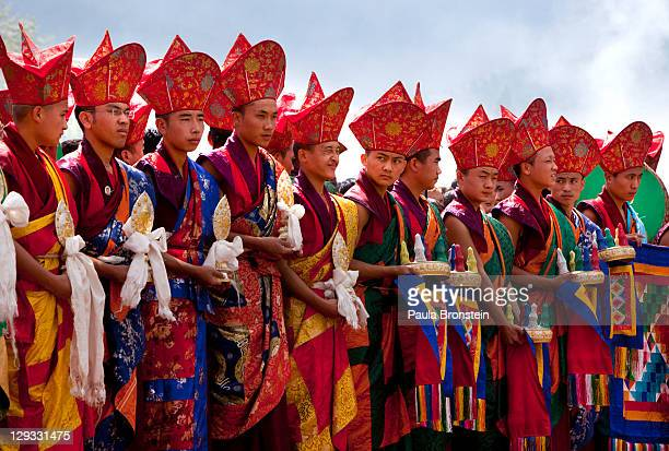 A procession of monks stands for a new Thangkha painting to be unveiled during a special Buddhist ceremony to celebrate the new royal couple King...