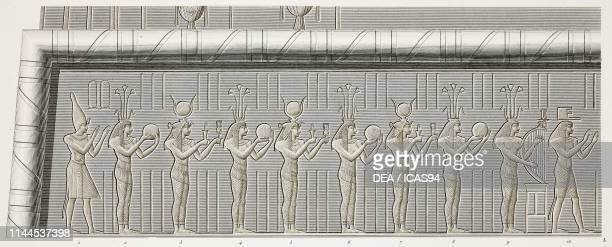Procession of offering bearers to goddess Isis, frieze on the facade of Hathor Temple portico, Dendera Temple complex, Egypt, detail, engraving after...