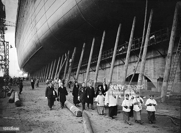 A procession of priests blessing the ocean liner NORMANDIE in October 1932 before its launching which took place on October 29 1932