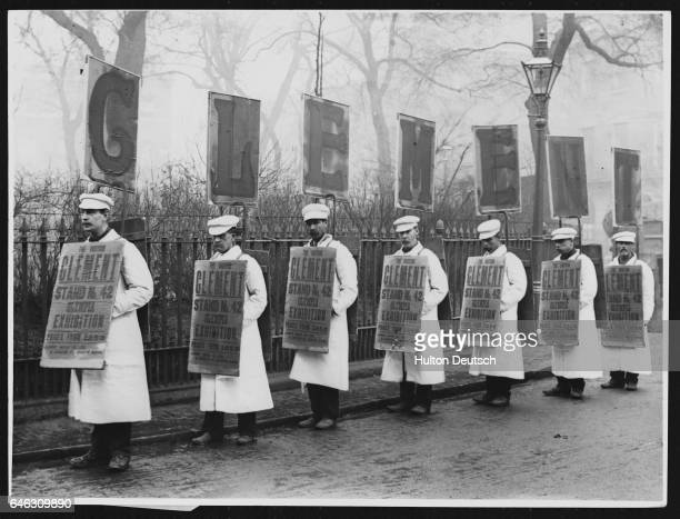 A procession of sandwich board men advertising a product call 'Glement'