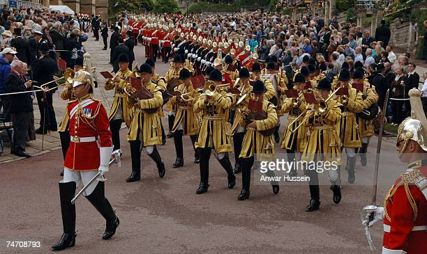 A procession of soldiers makes its way to the Order of the Garter Ceremony at St George's Chapel in Windsor Castle on June 18 2007 in Windsor England