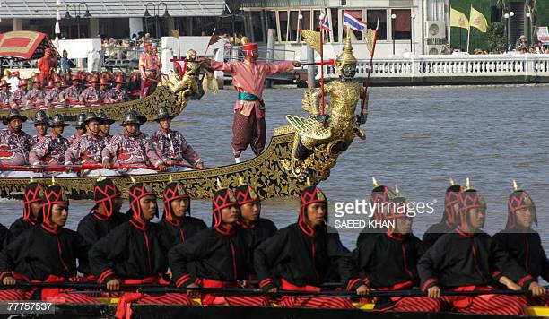 A procession of Thai Royal barge row past by the Grand Palace on the Chao Phraya River during the royal celebrations in Bangkok 05 November 2007 The...