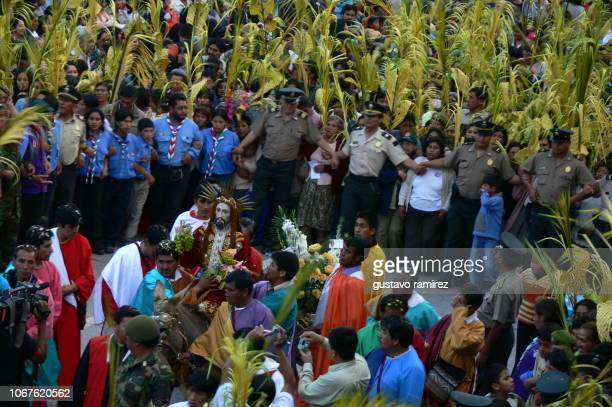 procession of the christ of palm sunday in easter in the city of ayacucho - christ is risen stock photos and pictures