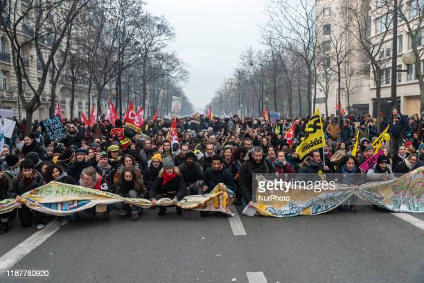 Procession of trade unionists strikes organizes a sit-in during the demonstration on Tuesday, December 10 while several thousand people responded to...