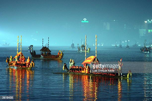 A procession takes place on the river Chao Phraya at the start of the APEC summit October 20 2003 in Bangkok Thailand World leaders are gathering in...