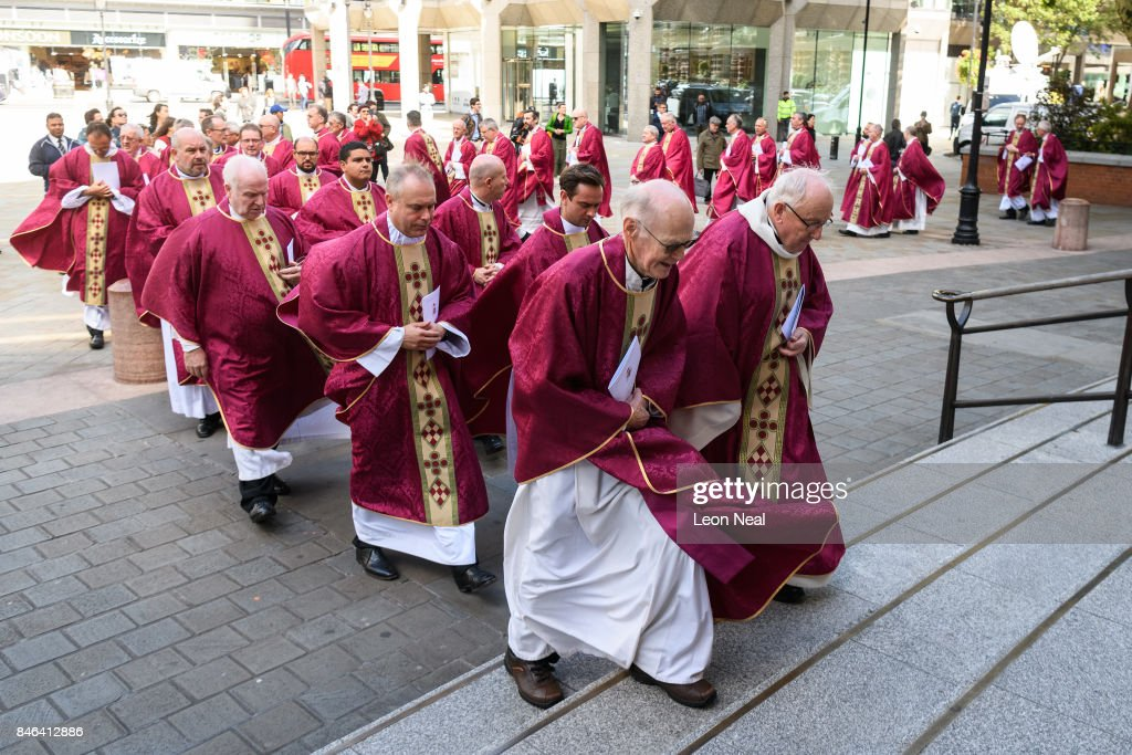 A procession walks towards the front doors of Westminster Cathedral for the funeral of the late British Cardinal Cormac Murphy-O'Connor, on September 13, 2017 in London, England. The 85-year-old died on September 1 after a battle with cancer.