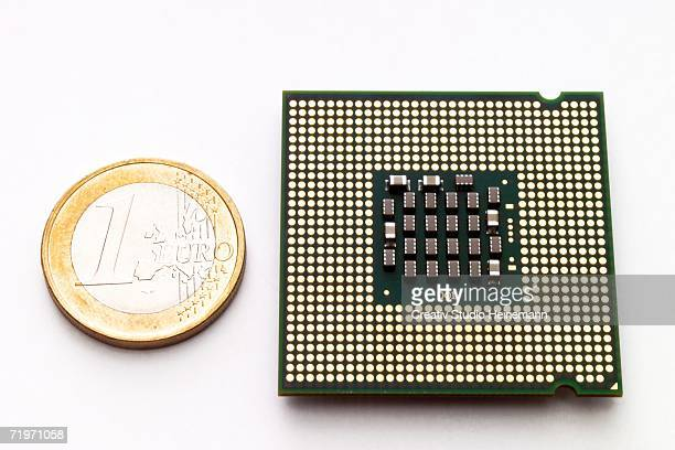 processor chip by euro-coin, elevated view - 1 euro photos et images de collection