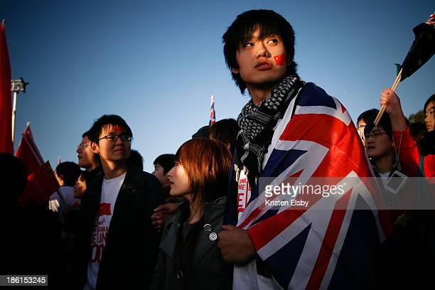 CONTENT] A proChina supporter shows his support for Australia at the 2008 Olympic torch relay as it passes through the nation's capital The Chinese...