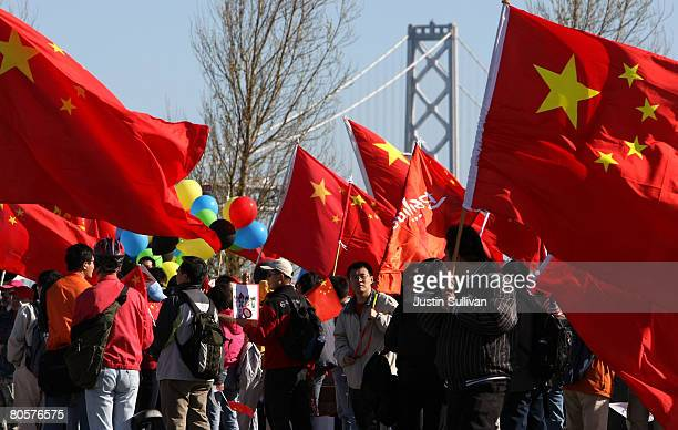 ProChina supporters wave flags near the San Francisco Bay Bridge as they await the start of the Olympic Torch Relay April 9 2008 in San Francisco...