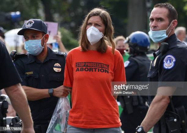 Pro-choice activist is arrested during a demonstration outside of the Supreme Court on October 04, 2021 in Washington, DC. The Supreme Court's new...