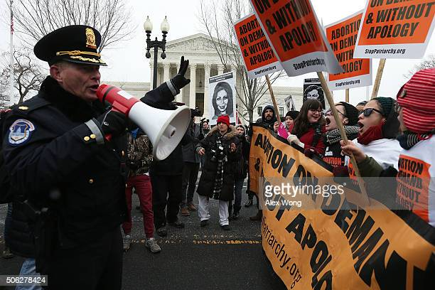 Pro-choice activists are warned by a member of the U.S. Capitol Police as they try to block the way for the 2016 March for Life event outside the...