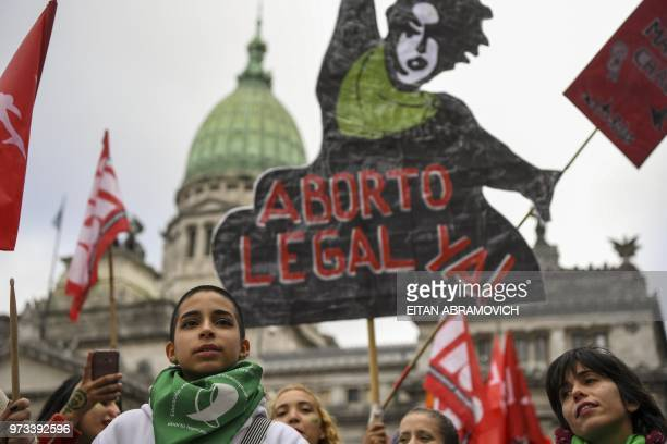Prochoice activists calling for the approval of a bill that would legalize abortion demonstrate in front of the Argentine Congress in Buenos Aires on...