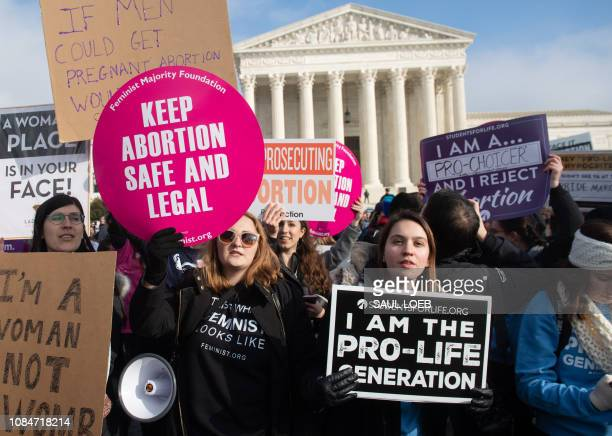 Prochoice activists hold signs alongside antiabortion activists participating in the March for Life an annual event to mark the anniversary of the...