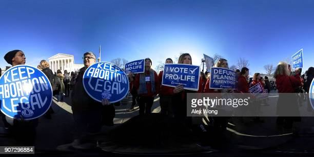 Prochoice activists hold signs as they counterprotest in front of the the US Supreme Court during the 2018 March for Life January 19 2018 in...