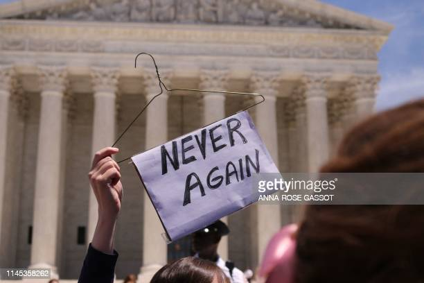 Prochoice activists join a rally in support of women's rights in front of the US Supreme Court in Washington DC on May 21 2019 Demonstrations were...