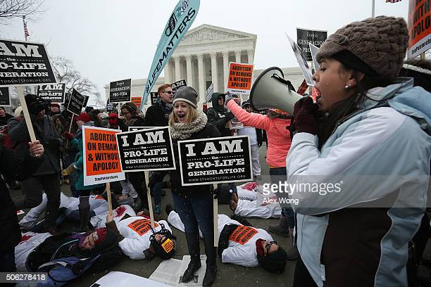 Prochoice activists participate in a diein during a 'Rise Up for Roe' rally outside the US Supreme Court as prolife activiests intervene during the...