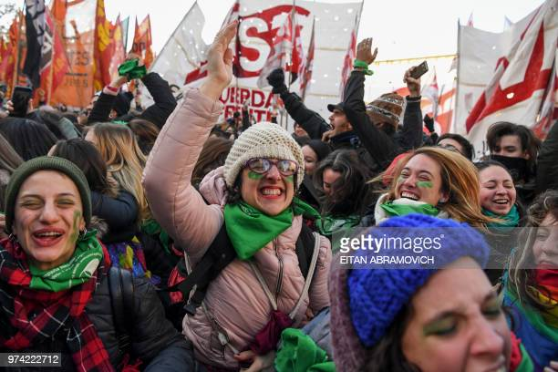 Prochoice activists react outside the Argentine Congress in Buenos Aires on June 14 shortly after lawmakers approved a bill to legalize abortion...