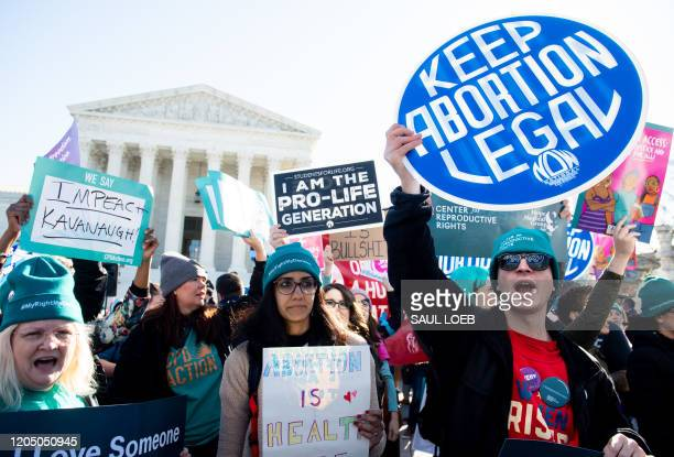 Pro-choice activists supporting legal access to abortion protest during a demonstration outside the US Supreme Court in Washington, DC, March 4 as...