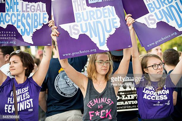 Prochoice activists wait for rulings in front of the US Supreme Court on June 27 2016 in Washington DC A ruling is expected in Whole Woman's Health v...
