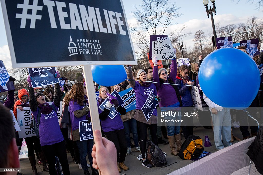 Pro-choice advocates (left) and anti-abortion advocates rally outside of the Supreme Court, March 2, 2016 in Washington, DC. On Wednesday morning, the Supreme Court will hear oral arguments in the Whole Woman's Health v. Hellerstedt case, where the justices will consider a Texas law requiring that clinic doctors have admitting privileges at local hospitals and that clinics upgrade their facilities to standards similar to hospitals.