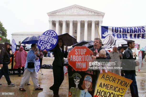 Prochoice and antiabortion activists demonstrate in front of the Supreme Court building as arguments on Nebraska's partial birth abortion law are...