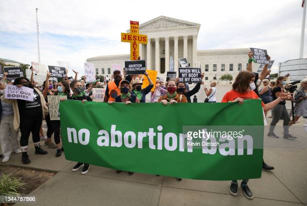 Pro-choice and anti-abortion activists protest alongside each other during a demonstration outside of the Supreme Court on October 04, 2021 in...